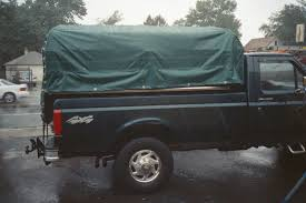 Truck Tarps/Covers Top Your Pickup With A Tonneau Cover Gmc Life Covers Truck Lids In The Bay Area Campways Bed Sears 10 Best 2018 Edition Peragon Retractable For Sierra Trucks For Utility Fiberglass 95 Northwest Accsories Portland Or Camper Shells Santa Bbara Ventura Co Ca Bedder Blog Complete Guide To Everything You Need