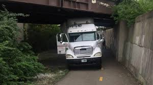 Truck Driving On Ohio Bike Path Hits Multiple Bridges, Gets Stuck ... Big Truck Is Stuck Too Tall For Henrico Bridge Wtvrcom Dodge Gets In Ocean During Commercial Shoot Photo Airport Parking Garage Blocked After Semi Fox13nowcom The Tow Truck Stuck In Mud Stock More Pictures Of Bog Another Got Under A Spokane Overpass 590 Kqnt Slows Traffic Sea Cliff Herald Community Newspapers Whoops Semi On The Beach North Carolina Garbage 100 Block Manton Street Passyunk Post River Youtube A 4x4 Mud Mountain Road Gurue I Some Rocks Tried Nudging It Free With