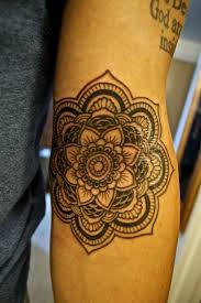 Black Outlined Tribal Lotus Tattoo On Hand