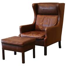Vintage Danish Brown Leather Armchair And Ottoman At 1stdibs Retro Brown Leather Armchair Near Blue Stock Photo 546590977 Vintage Armchairs Indigo Fniture Chesterfield Tufted Scdinavian Tub Chair Antique Desk Style Read On 27 Wide Club Arm Chair Vintage Brown Cigar Italian Leather Danish And Ottoman At 1stdibs Pair Of Art Deco Buffalo Club Chairs Soho Home Wingback Wingback Chairs Louis Xvstyle For Sale For Sale Pamono Black French Faux Set 2