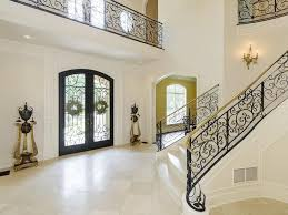 entryway with limestone tile floors crown molding zillow digs