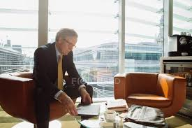 Businessman In Coffee Area Office Stock Photo