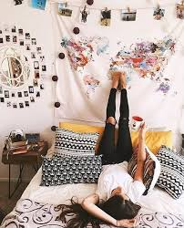 Hanging A Tapestry Is An Easy Way To Decorate Your Dorm Room On Budget