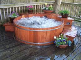 Stunning Round Hot Tub Idea Surrounded By Flowers On Backyard Deck ... Hot Tub On Deck Ideas Best Uerground And L Shaped Support Backyard Design Privacy Deck Pergola Now I Just Need Someone To Bulid It For Me 63 Secrets Of Pro Installers Designers How Install A Howtos Diy Excellent With On Bedroom Decks With Tubs The Outstanding Home Homesfeed Hot Tub Pool Patios Pinterest 25 Small Pool Ideas Pools Bathroom Back Yard Wooden Curved Bench