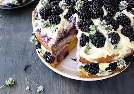 Sliced Olive Oil Cake Recipe With Berries On A Plate