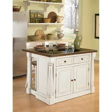 antiqued white kitchen island with granite top and two stools by