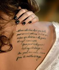 Nice Simple Strength Quote Tattoo On Upper Back