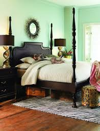 A 1920s Art Deco Style Room Bohemian Gypsy Bedroom With Dark Wood Four Poster Bed And Light Aqua Turquoise Walls