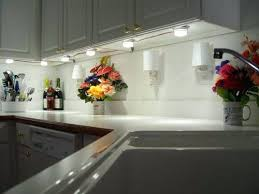 how to install lights kitchen cabinets granite diy