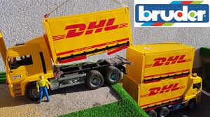 BRUDER Toys DHL Trucks And RC Tractor Transport Video | Wheels.Report