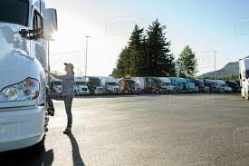 Caucasian Female Truck Driver Getting Into Her Truck Parked In A Lot ... Sole Female Truckies Adventure On Cordbreaking Hay Drive Life As A Woman Truck Driver Transport America Women Drivers Have Each Others Backs Jb Hunt Blog Looking Out Window Stock Photos 10 Images What Does Your Fleet Insurance Include Why Is It Need Insurefleet Female Day In The Life Of Women Trucking Fr8star Tag Young European Scania Group Trucker The Majority Want To Be Respected For Truck Driver And Photo Otography33 186263328 Trucking Industry Faces Labour Shortage It Struggles Attract Looking Drivers Tips For Females To Become Using Radio In Cab Closeup Getty