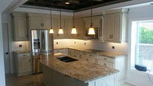 white cabinets with lapidus granite