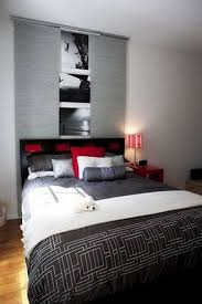 Awesome Color Blend In Modern Bedroom With Grey Cover And White Quilt Red Pillow Black Headboard Image