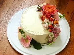 A beautiful triple layer chocolate cake covered it stunning fresh flowers A fabulous cake to celebrate a fabulous couple