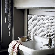 fish patterned tiles above the sink founterior