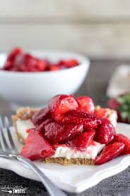 Slice of Strawberry Pie on a White Plate with a Fork