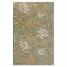 wool rug with a floral trellis motif tufted in india