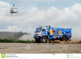 Truck Rally Truck KAMAZ On Dust Road With A Flying Helicopter ... Rc Helicopter Truck Coast Guard Air Sea Rescue Remote Control World Tech Toys Introduces The Rc Mega Hauler And Helicopter On Truck Stock Photo Royalty Free Image 34296775 Alamy Semi With Best Resource Urban Force Ourkidseg Helicopter Being Transported On A Flatbed Truck The Highway In Swiss At Balzers Heliport Liechnstein Flickr Monster Trucks Police Cars Chasing Cartoons For Robinson R22 Next To A Fuel Fostaire Images Sky Fly Aircraft Transport Vehicle Aviation Blue Watch Amazon Deliver Seat Mii By And Westland Scale Model Drew Pritchard Ltd