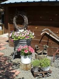 Planting Flowers In Funky Containers For A Rustic Look
