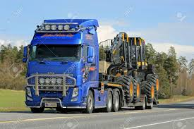 100 Scorpion Truck KAARINA FINLAND MAY 2 2014 Volvo FH Hauls Ponsse