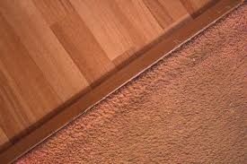 Laminate Floor Transitions Doorway by How To Transition From Laminate Floor To Carpet Hunker