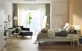 White And Wood Hotel Room With Bed Desk Chaise Lounges A Sea View