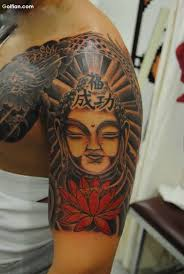 Awesome Asian Buddha And Lovely Flower Tattoo Design Make On Upper Sleeve
