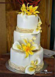 wedding cake white wedding cake with yellow flowers wedding cake with cala lilies and