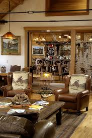 Rustic Western Ranch Home Love The Cowboy Chairs And Antler Chandeliers Living RoomsLiving