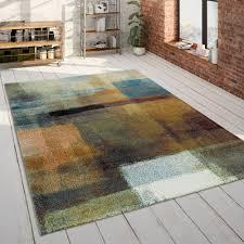 skandi teppich wohnzimmer blau orange rauten muster pastell