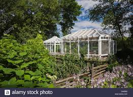 Solarium And Flower Garden In Backyard, Quebec, Canada Stock Photo ... Sunroom Kit Easyroom Diy Sunrooms Patio Enclosures Ashton Songer Photography Blogjosh And Bridgets Beautiful Spring Pergola Awesome All Seasons Gazebo Penguin Four Season Rates Services I Fiori Della Cava Floating Tiny Home Amazing Ocean Backyard Small House Design Skyview Hot Tubs Solarium American Hwy Residential Greenhouses Greenhouse Pool Cover 11 Epic Outdoor Structures Flower Garden In Backyard Quebec Canada Stock Photo Orange Private Room At Fort Collins Colorado United Steals The Show This Renovated Midcentury