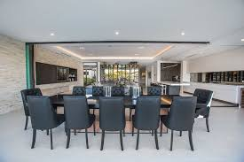 Mckelvey Homes Modern Dining Room Also Bifold Door Tables Kitchen Leather Chairs Outdoor Entertaining Stone Walls