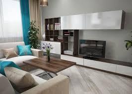 wohnwand aus dunklem holz mit weißen fronten living room