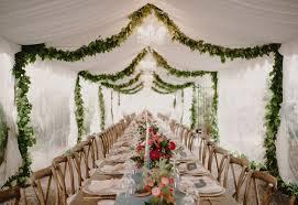 Artistically Arranged Garlands Enhance The Mood Of Rustic Wedding Theme