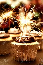 Party cupcakes decorated with chocolate ganache and sparklers Stock