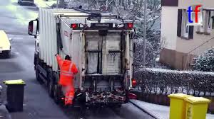 White Garbage Truck In The Snow - MAN Remondis Plastic Recycling ...