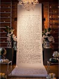 DIY Wedding Ceremony Backdrop With Vows Written On Giant Paper Scroll