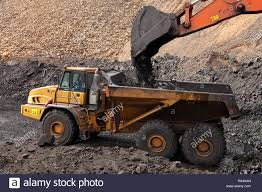 100 Rock Trucks Open Pit Manganese Mining Excavator Digging Out Ore Rich Rock And