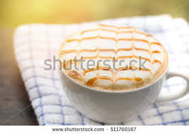 Coffee Cup Of Latte Art Caramel Topping On Dish Towel Sunlight Background Cappuccino Hot