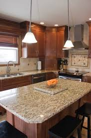 maple nutmeg cabinets with granite tops and light colored floor