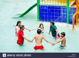 Happy Indian Family Waterpark Swimming Pool Bathing Enjoy Circle