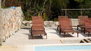 Wooden Deck Chairs Dark Wood In An Empty Swimming Pool Stock Video Footage