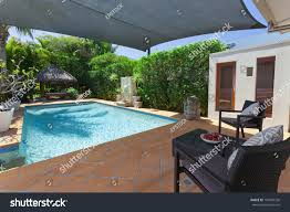 Modern Backyard Swimming Pool Bali Hut Stock Photo 107894726 ... Good News This Mansion With An Unreal Private Backyard Water Deluxe Cedar Kids Playhouse Discovery 32m Texas Mansion Has Waterpark Inground Trampoline In Backyard Rachel Ben And Their Perfect New England Diy Wedding Impressive Indian Village With A Pool Sells For Above Grey Gardens Sale The Resurrection Of Big Edie Beales Victorian Playsets Boca Raton 37foot Waterfall Lists 13m Curbed Abandoned The Documentation Center Creative Small Pool Designs Waterfall Multilevel Design Awesome House Fire Pit Description From