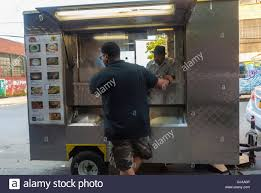 Man Buying From Food Truck Stock Photos & Man Buying From Food Truck ... Are You Financially Equipped To Run A Food Truck Mobi Munch Inc 50 Ideas For Mobile Business That Does Not Sell Food Airstream Foote Family Nomad Langos New York Trucks Roaming Hunger Guide Falafel Bar The Buffalo News Roxys Grilled Cheese Brick And Mortar Association How Build Yourself A Simple Whats In Truck Washington Post Sale Metallic Cartccession Kitchen 816 Youtube