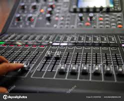 Soft Focus Hand Adjusting Professional Digital Audio Mixer Controller In The Control Room Sound For Live Music And Studio Equipment