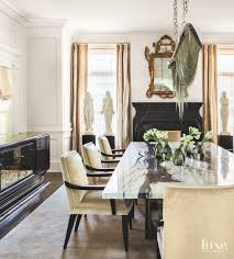 Eclectic Dining Room With Unique Chandelier Statues Marble Table