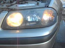 how to install replace headlight and bulb chevy impala 00 05