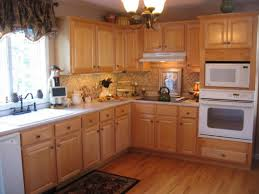 Small Square Backsplash Tiles With Resin Statue Tablet Stand Maple Floor Kitchen Distressed Wood Cabinets Natural