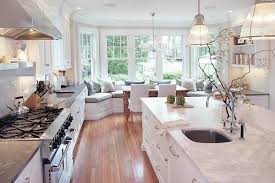 Ultra Modern French Country Galley Kitchen Design With Marble Island And Pendant Lamp Image