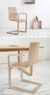 The Wood Of These Chairs Has Been Bent Into A Curved Seat With High Arm Rests That Have Just Right Amount Give